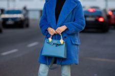 05 a classic blue over the knee coat is a bold and trendy touch to the look, and you'll feel comfy in it