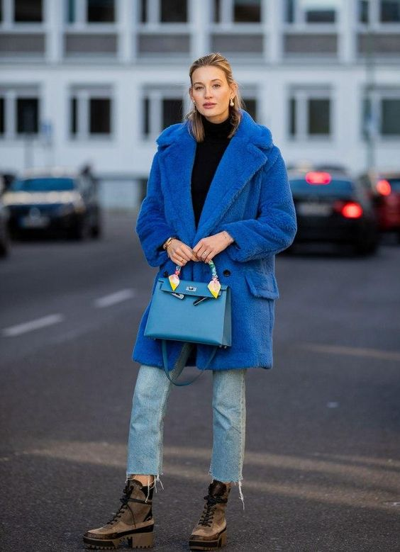 a classic blue over the knee coat is a bold and trendy touch to the look, and you'll feel comfy in it