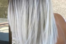 05 a darker root and silver blonde balayage for a chic and bold look with a trendy feel