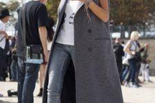 05 a printed tree, grey jeans, black cutout boots, a grey maxi sleeveless coat