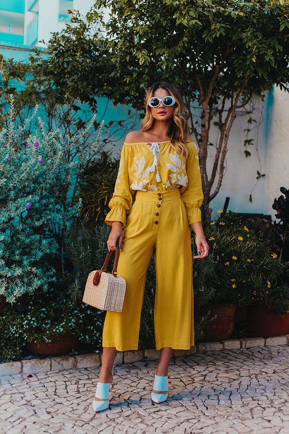 a whimsy look with a yellow lace boho off the shoulder blouse, matching high waisted culottes, blue shoes and a wicker bag