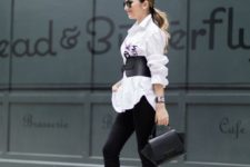 05 a white oversized shirt, black skinnies, a black leather corset belt, a black bag and two tone shoes