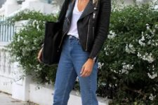05 a white top, blue straight jeans, a black leather jacket and printed slipper mules
