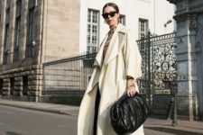 05 really an oversized black leather clutch is a gorgeous addition to a chic black and white monochromatic look