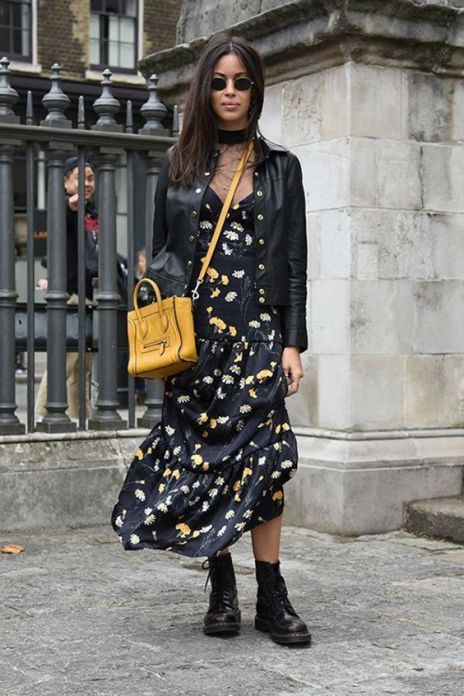 a black floral maxi dress, a black leather jacket, combat boots and a yellow bag plus a choker
