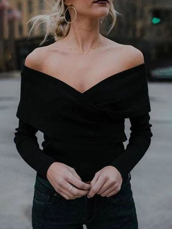 a black off the shoulder top with a deep neckline, navy skinnies for a date night or a night out
