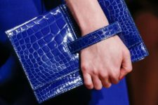 06 a classic blue crocodile leather clutch with a handle is a cool and chic fashion statement for this year