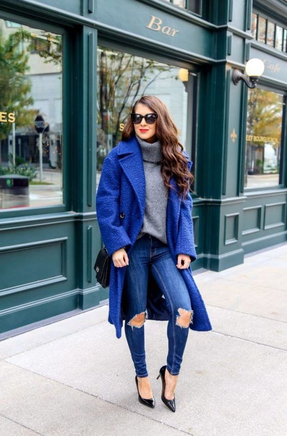 a grey turtleneck sweater, ripped skinnies, a classic blue coat, black shoes and a black bag