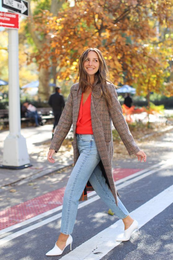 a red shirt, light blue straight jeans, whimsy white shoes and a chhecked brown coat