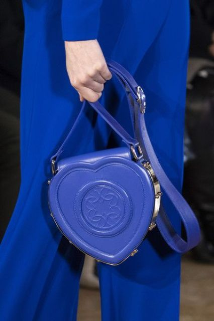 a classic blue heart-shaped bag is a very whimsy accessory that is great for special occasions