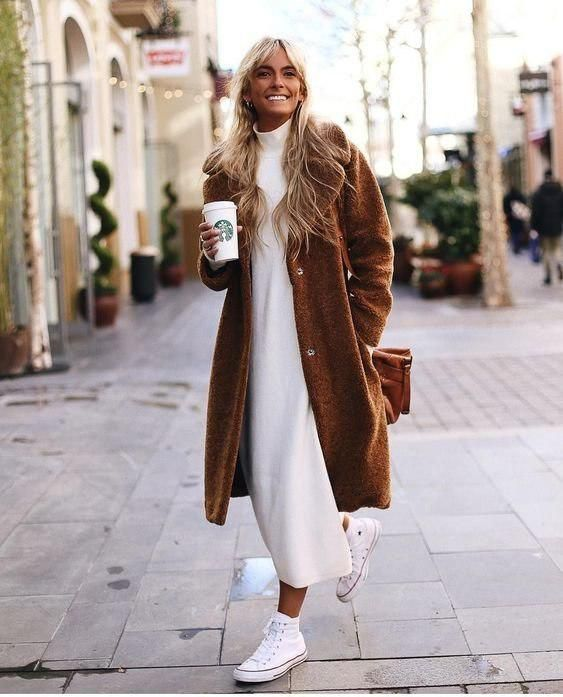 a white turtleneck midi sweater dress, white sneakets, a brown faux fur coat and a brown bag