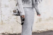 08 a monochromatic grey outfit with a chunky knit sweater, a midi skirt, white sneakers, a scarf and a bag