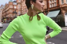 08 a neon green top, brown pants and statement earrings with brown detailing for an edgy look