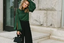 08 an elegant deep green blouse with long bell sleeves on black buttons and black pants