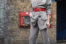 09 a grey pantsuit, a red wide waist belt and two tone sneakers for an ultra-modern and bold look
