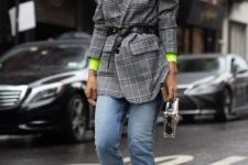 09 a neon green turtleneck, blue straight jeans with a raw hem, an oversized checked blazer and a silver bag