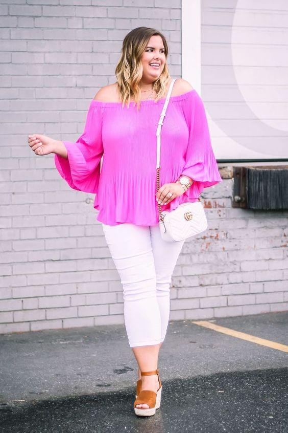a neon pink off the shoulder top features 2 trends in one, white jeans, brown shoes and a white bag