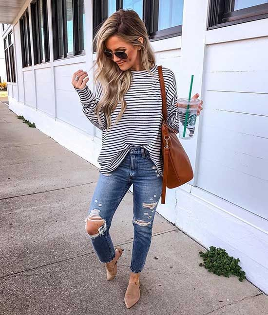 a striped top, blue ripped jeans, neutral slipper mules and a brown tote