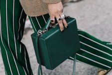 10 a deep green box leather bag is a gorgeous accessory, which isn't practical but is cool