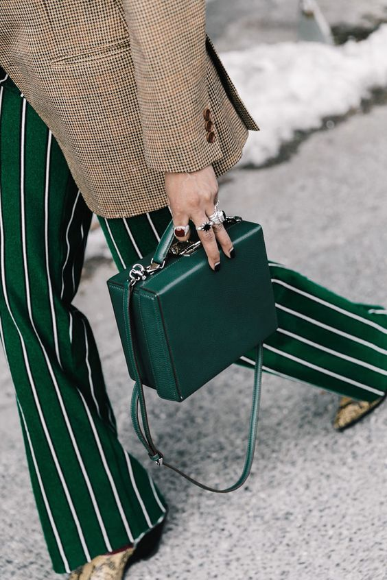 a deep green box leather bag is a gorgeous accessory, which isn't practical but is cool