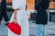 10 a light and romantic white midi dress paired with a hot red soft clutch for a colorful statement