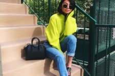 10 a neon yellow sweater, blue mom jeans, floral mules and a black bag for spring