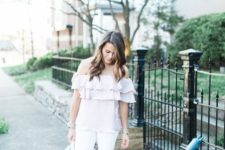10 a pastel spring look with a blush off the shoulder ruffle top, white jeans, a white bag and nude lace up shoes