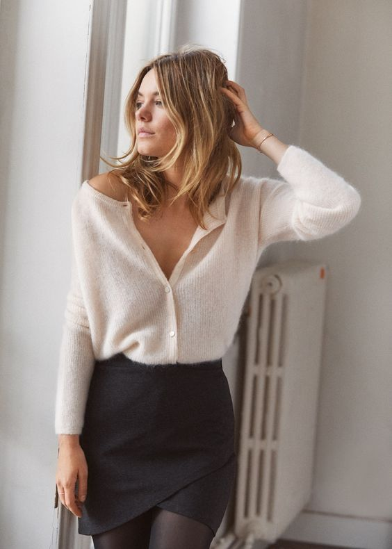 a sexy look with a white angora cardigan as a top, a black mini skirt and black tights