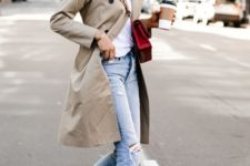 10 a white tee, light blue ripped jeans, white sneakers, a neutral trench and a red bag