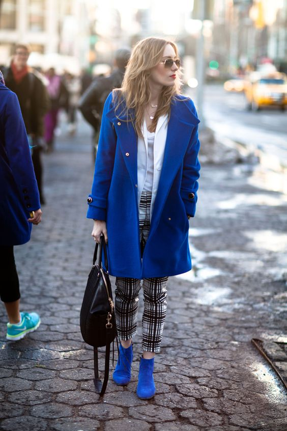 spruce up your neutral or monochromatic outfit with a classic blue coat and booties for a trendy feel