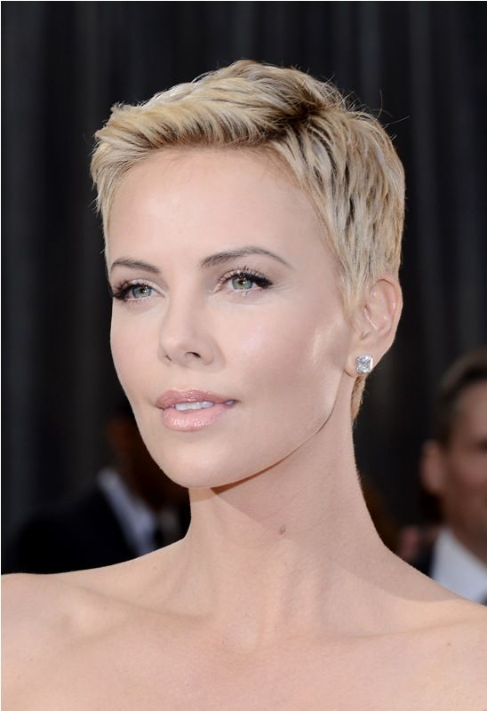 Charlize Theron rocking a chic short blond pixie haircut looks heavenly
