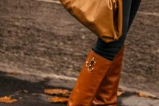 a monochromatic fall outfit finished off with a matching soft clutch in an ocher shade