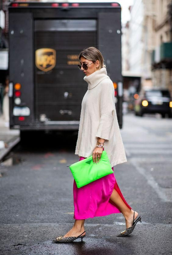 a nude cashmere oversized sweater, a neon pink maxi skirt, kitten heels and a neon green clutch