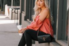 11 a pink off the shoulder top, black skinnies, rust-colored high heels and a black bag for Valentine's Day