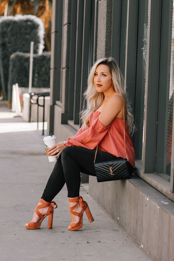 a pink off the shoulder top, black skinnies, rust colored high heels and a black bag for Valentine's Day