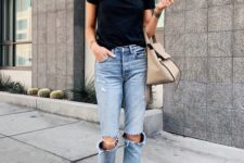 11 a simple black tee, blue ripped jeans, white sneakers and a beige bag