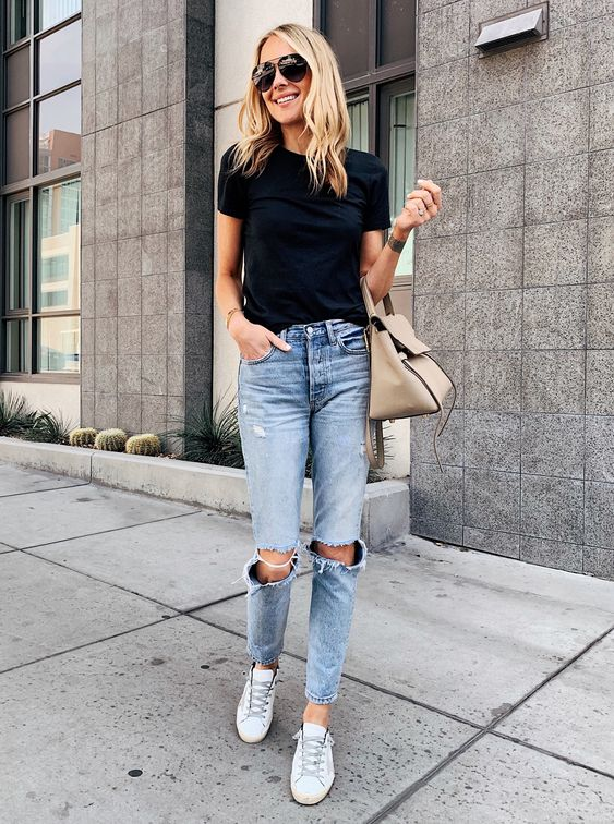 a simple black tee, blue ripped jeans, white sneakers and a beige bag
