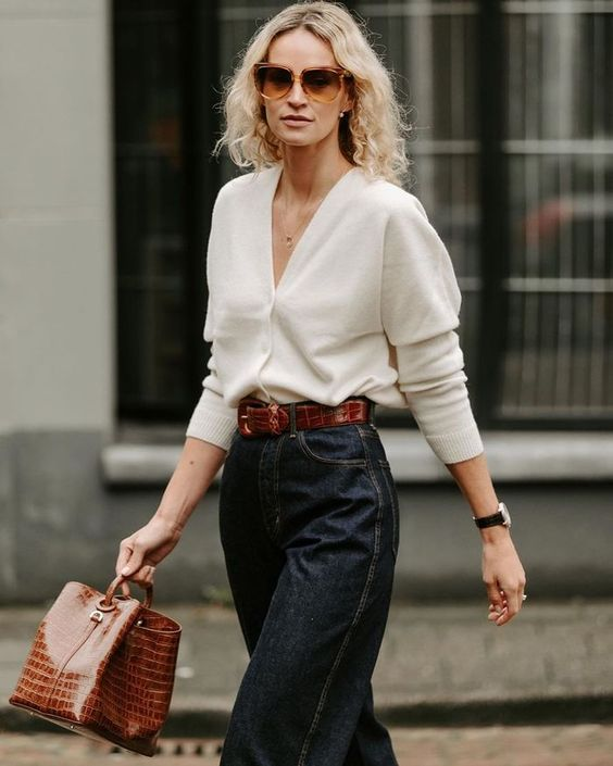 a white cardigan worn as a top, black straight jeans, a brown crocodile bag and a matching belt