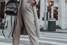11 rock white trainers and joggers with a basic coat and a chic bag to raise your look to a new level