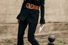 12 a black pantsuit with a wide brown leather belt, black embellished shoes and a statement necklace