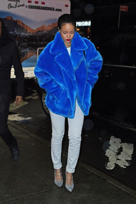 a classic blue faux fur short coat with a zip is stylishly rocked by Rihanna