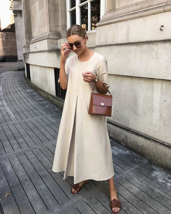 a comfortable ivory A-line minimalist midi dress, burgundy slippers and a matching bag