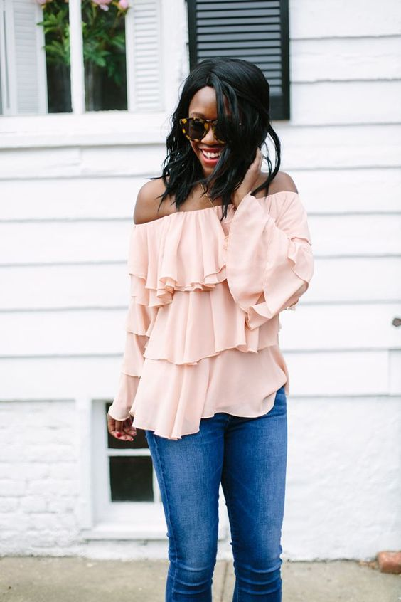 a romantic spring outfit with a layered blush off the shoulder top, which is 2 trends, and blue jeans