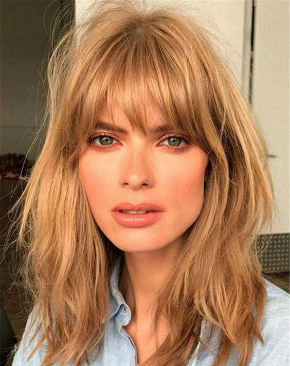 messy caramel hair with shaggy bangs will give you a trendy 70s inspired look