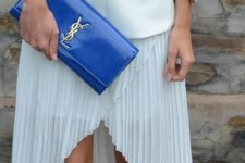 13 a classic blue shiny clutch with gold detailing by Yves Saint Laurent is a cool colorful statement