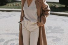 13 a neutral look with a V-cut sweater, creamy pants, two-tone shoes and a classic camel coat