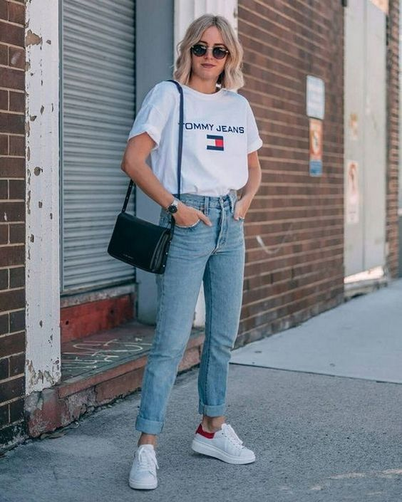 a white printed tee, light blue boyfriends, white sneakers and a black bag for every day