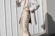 13 an ivory silk slip midi dress, a white oversized blazer and white trainers for a minimalist look