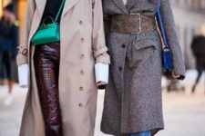 13 an oversized grey coat highlighted with a wide brown snakeskin belt with a giant buckle