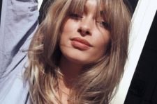 13 medium-length soft blond layered haircut with shaggy bangs is veyr romantic
